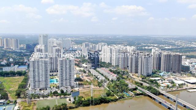 Ken đặc chung cư trên con đường ngoại ô Sài Gòn nhìn từ trên cao - Ảnh 6.