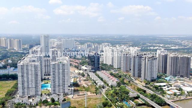 Ken đặc chung cư trên con đường ngoại ô Sài Gòn nhìn từ trên cao - Ảnh 7.