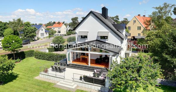 Ngôi nhà màu trắng mang nắng ngập tràn được thiết kế theo phong cách Bắc Âu nổi bật bên vườn cây xanh mát 3